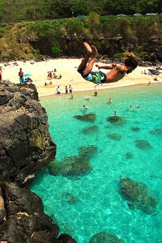 "jumping off ""da big rock"", Waimea Bay, on the island of O'ahu, Hawai'i"