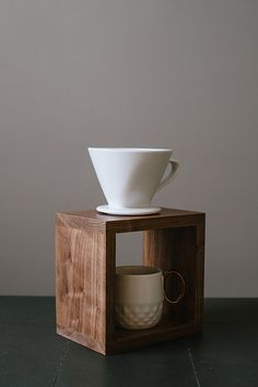 This listing is for one walnut wood coffee pour over stand. All stands are coated to protect them.    DIMENSIONS: 8 x 8 x 5.5 for single mug stand.