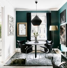 •the dark green works well with touches of gold against it. This would suit a study or library room•