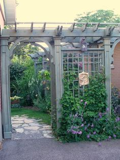 The perfect pergola/arbor to go next to the garage, leading to the backyard gardens!