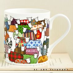 Fine Bone China Colourful Sheep Mug featuring Mary Kilvert's Flock of Colourful Sheep illustration. Height: 8.5cm. Diameter: 7.5cm. Holds 9 fluid ounces of liquid. Dishwasher safe. Shipped in protective packaging.
