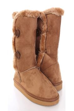 Be comfy yet stylish this season with these fashionable flat boots! They will go perfect with your favorite sweater dress or skinnies! Make sure you add these to your closet, it definitely is a must have! The features include faux suede upper with faux fur trim, side button accents, round closed toe, stitched detailing, mid calf length, soft faux fur lining, and cushioned footbed. Approximately 1 inch platforms, 15 inch circumference, and 10 inch shaft.
