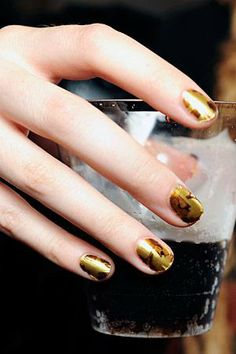 Gold nails at Alexander McQueen S/S11