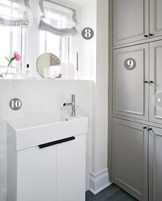 Mudroom sink with marble shelf ledge and grey built in cabinets www.cromadesign.com  http://www.styleathome.com/decorating-and-design/styling-secrets/14-ways-to-redecorate-a-mud-and-powder-room/a/46279 #styleathome