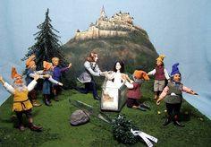 Snow White and the Seven Dwarfs miniature wooden dolls by Hanna Hyland. http://www.alisasinternationaldollart.com/live/artists/HannaHyland/HHMini.shtml