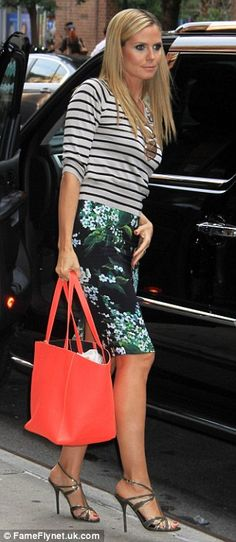 Elegant lady: Earlier in the day Heidi was chic in a black and green-flowered skirt and striped top to go shopping with Martin Flower Skirt, Heidi Klum, Elegant Woman, Go Shopping, Vince Camuto, Supermodels, Boyfriend, Yellow, Chic