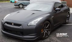 Custom matte black wrap on a 2010 Nissan GT-R by 12-Point SignWorks in Franklin, TN.