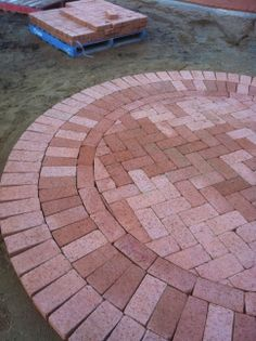 www.pavingcanberra.com Paving Front Yard: Path and Paved Circle.  Paving Backyard: Path and Entertaining Area. Paving Product: PGH Tumbled Clay Paver 230 x 115 x 50mm. Edging: Paver lengthways. Landscaping: Crushed Granite.