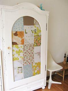 dottie angel• beautiful antique armoire, vintage quilt behind glass