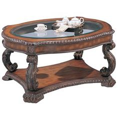 Doyle Traditional Oval Cocktail Table with Glass Inlay Top