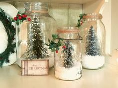 We love the idea of mini pine trees dusted with Epson Salt snow in different size mason jars. You can pick up the mini trees at the dol...