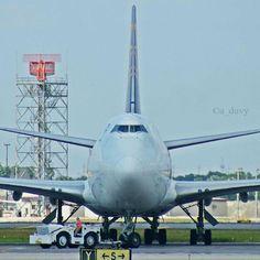 Face to face with an Atlas Air Boeing B747-4F freighter being towed toward the ramp at KMIA - by a_duvy