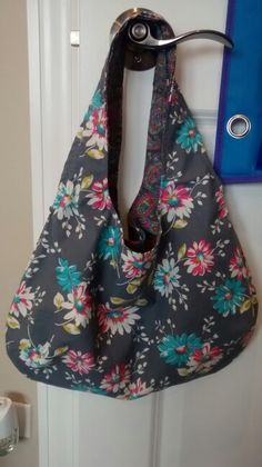 Grey and turquoise petite reversible sling purse in floral and paisley