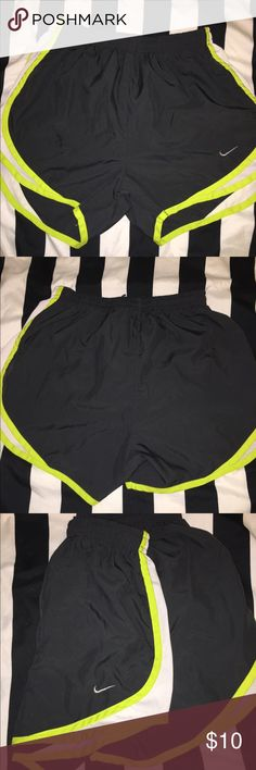 Nike Dri-fit running shorts Barely worn running shorts. Has built in undies and a spot for your keys. Love these type of shorts but don't fit me anymore. Nike Shorts