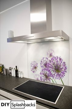 Allium printed glass splashback. Shop from over 400 designs, or provide your own. All of our splashbacks are: Heat Resistant to 200 degrees, toughened safety glass, available in any size, and all come with a seven year warranty. Visit diysplashbacks.co.uk to discover more.