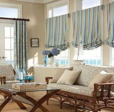 Cape Cod Interior Style- love the curtains and neutral colors mixed with blue