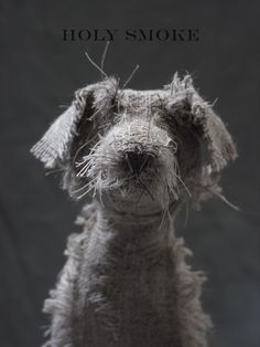Holy Smoke - these dog sculptures are by UK-based artist Helen Thompson aka Holy Smoke. She creates these expressive canines from wire, natural linen, and vintage textiles.