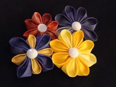 Kanzashi Fabric Flower pins.  Click photo for tutorial.
