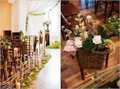 Lovely rustic vintage floral touches, if the venue would allow we love the use of the moss to line the aisle