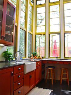 yellow kitchen window frames, farmhouse sink, cherry cabinets- love the tall windows Home Interior, Kitchen Interior, Eclectic Kitchen, Luxury Interior, Interior Ideas, Modern Interior, Kitchen Spotlights, Mediterranean Kitchen, Spanish Kitchen