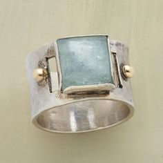SEA VISTA RING -- Like a window on the sea, an aquamarine cabochon is framed by hand in sterling silver—each bezel therefore one-of-a-kind. The band is hammered sterling sparked with 14kt gold granulation beads. Whole sizes 5 to 9