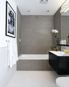 Bathroom contemporary bathroom - modern tiles, no bitsy borders, so makes small spaces look bigger!