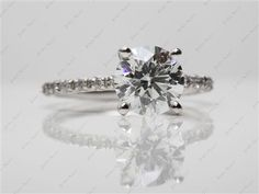 Platinum Thin French-Cut Pave Set Diamond Engagement Ring with Round 1.51 Carat I VS2 Ideal Cut Diamond.