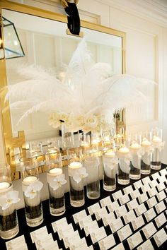 Old Hollywood Glamour wedding ideas, Feather arrangement in the escort card table #escortcardtable