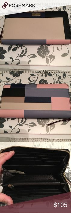 Kate Spade Newberry Lane Wallet Beautiful wallet. All the many colors and tons of pockets. It also has a slip pocket on the back of the wallet. It is new with the tags. kate spade Accessories