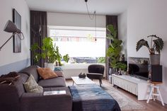 The TV unit as well as the black floor lamp between the sofa and window are from IKEA.