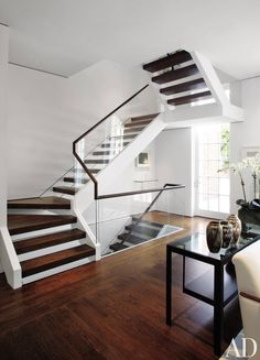 Find home décor inspiration at Architectural Digest. Everything you'll need to design each and every room in your house, from the kitchen to the master suite. Glass Stairs, Wood Stairs, House Stairs, Carpet Stairs, Basement Stairs, Floating Stairs, Wood Walls, Grey Walls, Concrete Stairs