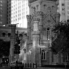 """The Old Chicago Water Tower. As 9"""" x 9"""" Matte Black Metal Framed Print."""