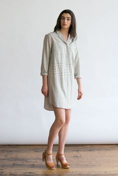 A notched-collar, long-sleeved shirt dress with a boxy fit, rear yoke box pleat, and two chest patch pockets. Everyone needs at least one of these. In Washed Stripe. 55% Linen, 45% Cotton. Model is 5'