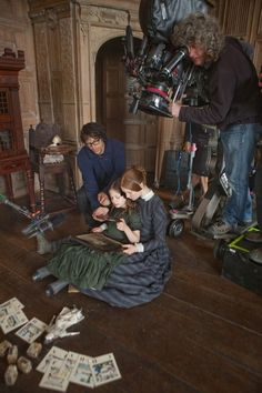 On the set with Director Cary Fukunaga: Romy Settbon Moore (Adèle Varens) & Mia Wasikowska (Jane Eyre) - Jane Eyre (2011)