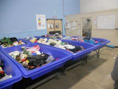 Bins containing unsold Goodwill items.