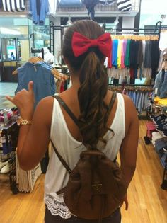 curly ponytail and big bow