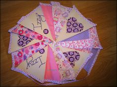 Bespoke bunting all with hand embroidery feature. Made in colours to suit and available in a range of sizes. This bunting have flags that measure 18cm x 28cm x 28cm and is priced per metre. 5 flags per metre plus ties each end