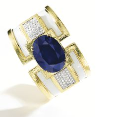 18 KARAT GOLD, PLATINUM, SAPPHIRE, DIAMOND AND ENAMEL CUFF-BRACELET, DAVID WEBB Centering an oval-shaped sapphire weighing 73.03 carats, flanked by panels set with round diamonds weighing approximately 2.10 carats, applied with white enamel, gross weight approximately 90 dwts, internal circumference 6½ inches, signed David Webb, numbered BCS51. With signed box.