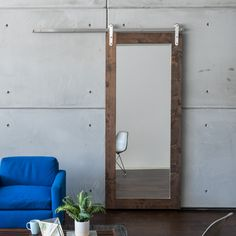 The Modern Mirror Sliding Barn Door comes ready with an installed body mirror on one side. Browse more styles and customize a barn door at Artisan Hardware.