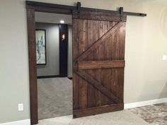 Sliding doors have quickly grown in popularity and are making a stunning impact. Add a reclaimed wood sliding barn door to your home or office as functional art! Barn Door Decor, Wood Barn Door, Barn Doors, Sliding Wood Doors, Wood Front Doors, Craftsman Farmhouse, Farmhouse Remodel, Reclaimed Wood Door, Barn Door Designs