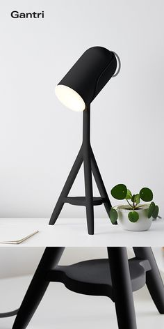 Black Model TL2 task light on a simple white desk, a stylish color combo for the minimalist urban creative. Designed and made by Gantri. Get it on gantri.com. #newmodern