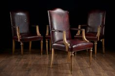 Set of 10 Vintage Burgundy Leather Dining Arm Chairs Arms are Set Back, Frames Recently Refinished From France, Circa 1940s Seat: 19