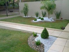 Landscaping--corner of retaining wall.  I like the two different types of rocks.  Maybe mulch and rocks instead.