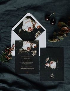 Break tradition by using chic dark and moody florals at your fall or winter wedding, like these edgy dark printed invites!