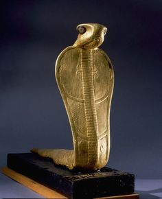 Gold statue of Netjer-Ankh (living god) made of gilded wood found in one of the black shrines of the Tutankhamun burial.