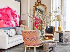 Feminine living room with tall branches as décor