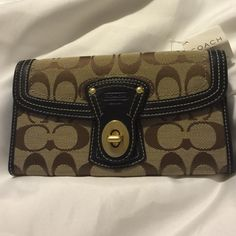 Coach Legacy Signature Canvas Wallet. New, Unused! Perfect, gorgeous Coach Legacy Signature wallet with trademark patterned brown and tan canvas body and leather accents. Turn lock closure. New with price tag. Coach Bags Wallets