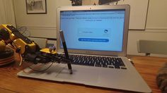 A Robotic Arm Successfully Beats an 'I Am Not a Robot' CAPTCHA Using a Stylus on the Trackpad