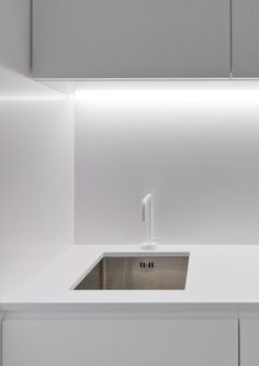 Kitchen with soft indirect lighting, the Zurcatnas office by Paulo Santa Cruz (© Joao Morgado) _