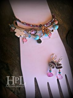 """bracelets-1-  strung czech pink glass, copper clasps, sterling silver hand charm w copper star-   7""""  2. leather bracelet natural color- wire wrapped crystal accents  7""""3.  glass beads (blue) , crystals , cats eye heart charms, magnesite white cross, pyrite hand carved flower- mother of pearl cross charm- wire .925 plated over copper metal. adjustable 2"""" chain-      fits 7"""" - 9"""" Earrings-    quartz faceted - pink color- magnesite blue sto..."""